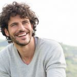 Dental Bridge or Dental Implant? Fill in the Blanks with Your Arlington Dentist